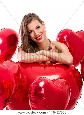 Portrait of smiling woman with Valentine's heart
