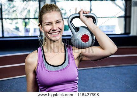 Portrait of woman holding kettlebell in crossfit