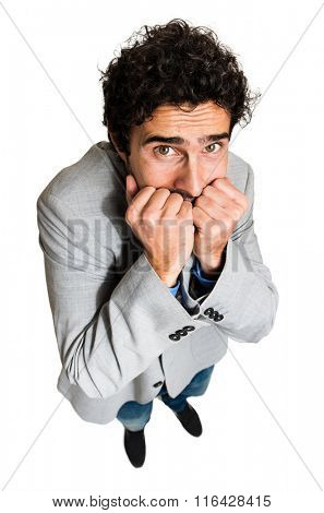 Portrait of a businessman with a funny scared facial expression