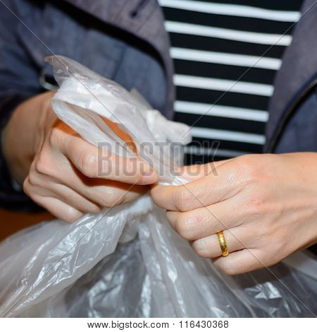 Hands Woman Binding Plastic Bag