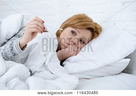Woman In Bed With Thermometer Feverish Weak Suffering Winter Cold Flu Virus