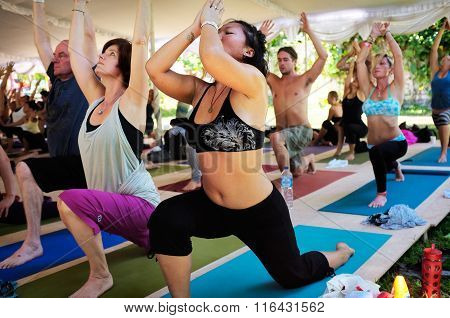 Mixed yoga class during the Bali Spirit Festival in Ubud, Bali, Indonesia