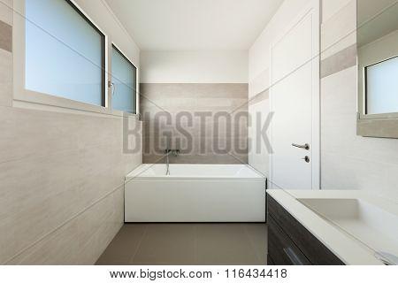 interior of new apartment, modern bathroom with bathtub