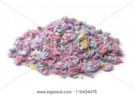 Pile of paper pet bedding isolated on white