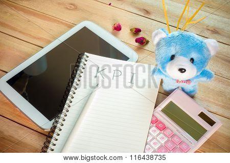 Kpi List Notebook With Tablet Calculator Pencil On Wood Floor , Digital Effect Vintage Style