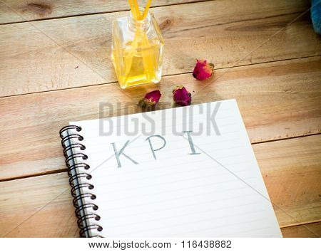 Kpi List Notebook With Pencil And Perfume And Rose On Wood Floor , Digital Effect Vintage Style