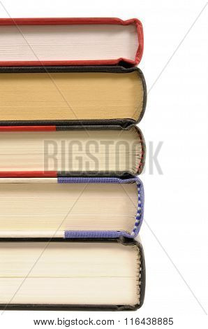 Small Stack Of Hardback Books Isolated On White Background.