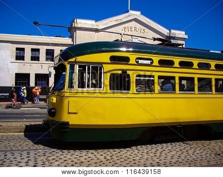 Yellow Tram Stopped At Pier 15 In San Francisco, California Usa