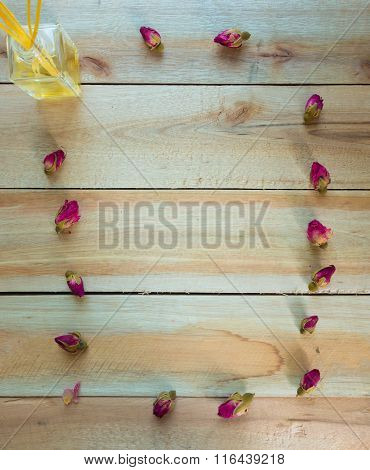 Roses Frame And Perfume Put On The Wood Floor With Copy Space,digital Effect Vintage Style