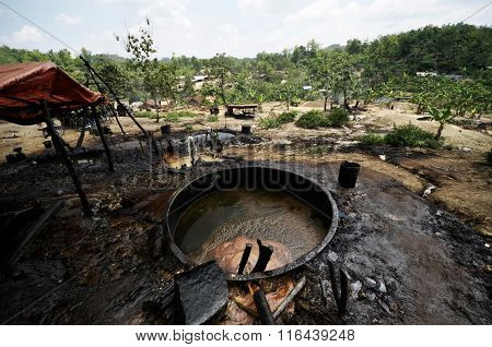 Highly polluted illegal oil field in East Java, Indonesia