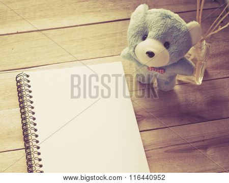 Soft Focus Notebook Paper With Light Blue Teddy On Wood Floor , Digital Effect Vintage Style