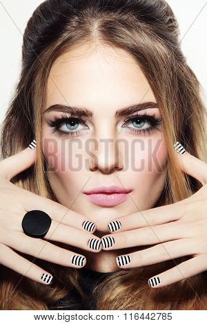 Portrait of young beautiful sexy girl with stylish make-up and striped manicure