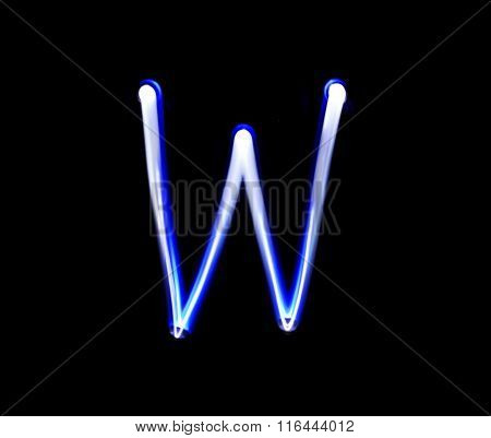 W Whiskey Alphabet Hand Writing Blue Light  Over Black Background.