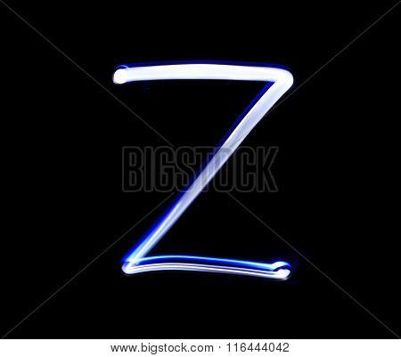 Z Zulu Alphabet Hand Writing Blue Light  Over Black Background.