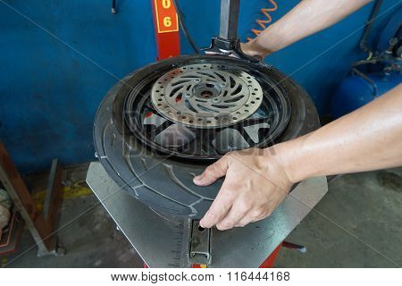 Mechanic Removes Tire Closeup
