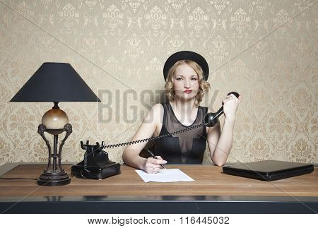 Secretary Takes Notes During A Call