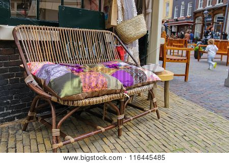 Wicker Sofa With Colorful Pillows In The Historic Center Of Haarlem, The Netherlands