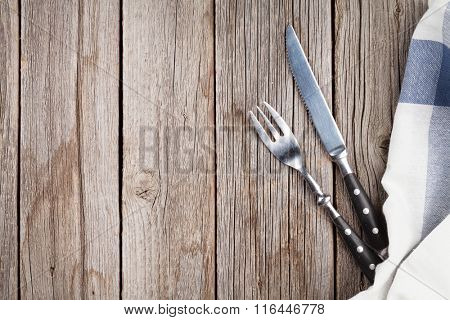 Silverware on wooden table. Top view with copy space