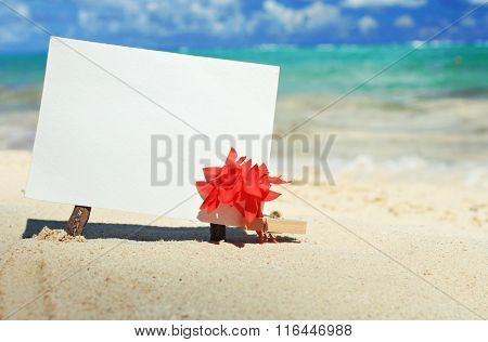 Message paper on tropical island beach.