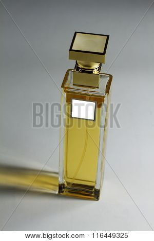 Elegant perfume bottle with label on gray background