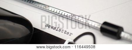 Newsletter text on retro typewriter