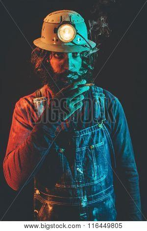 Bearded Miner Enjoying A Cigarette
