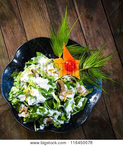 spinach salad recipe on wooden background