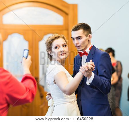 Guest Taking Photo Of Wedding Party