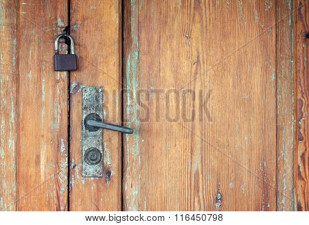Old Doors With Rusty Door Handle And Padlock