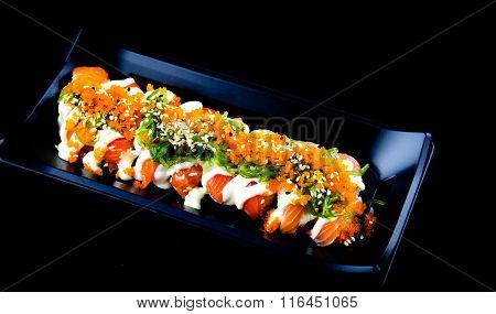 Fresh Sushi Served On A Black Plate