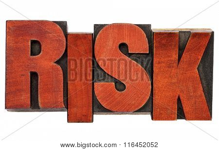 risk - isolated word abstract  in vintage letterpress wood type stained by red ink