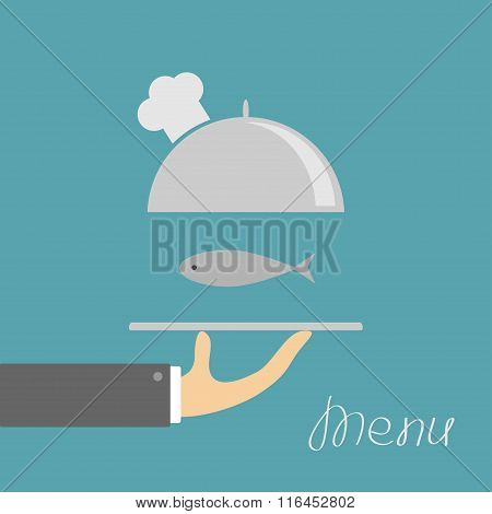Hand Holding Silver Platter Cloche With Chefs Hat And Fish. Menu Card. Blue Background. Flat Design.