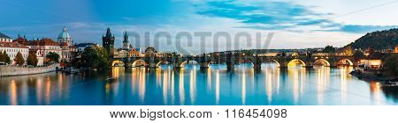 Night panorama scene with Charles Bridge in Prague, Czech Republ