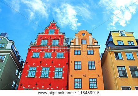 Red and Yellow iconic buildings on Stortorget a small public square in Gamla Stan