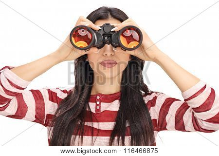 Studio shot of a young woman looking through black binoculars isolated on white background