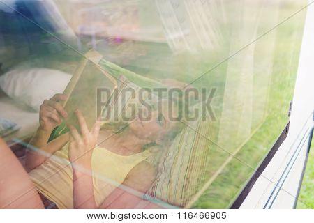 Beautiful woman in a camper van