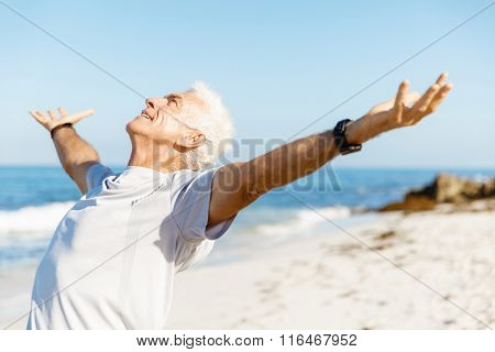Handsome man in sport wear with outstretched arms