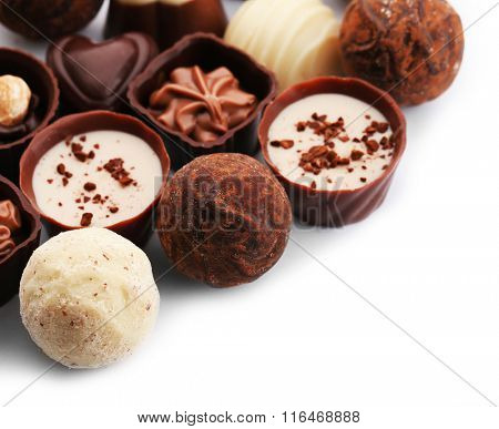 Assorted collection of chocolate candies and sweets, isolated on white
