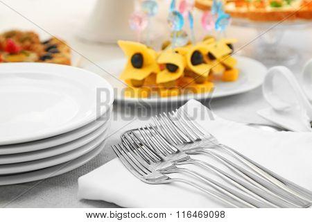 Dishware and snacks, closeup