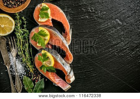 Salmon filets served on black stone