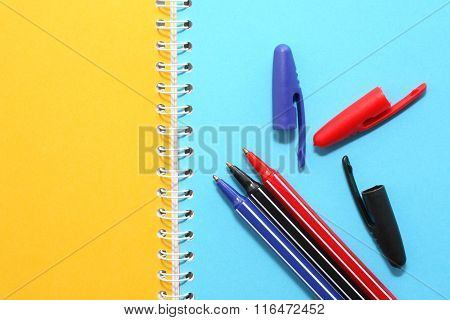 Pens On Notebook