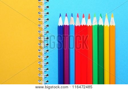 Pencils On Notebook