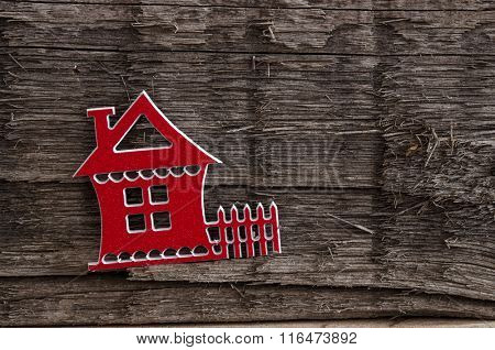 Symbol of the house on vintage wooden background
