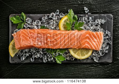 Salmon filet served on black stone