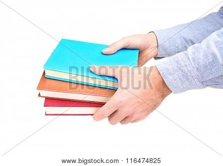 Man hands holding books, isolated on white