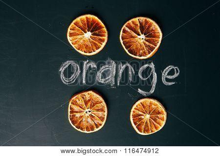 Four Cup Sliced Orange On A Black Background Board