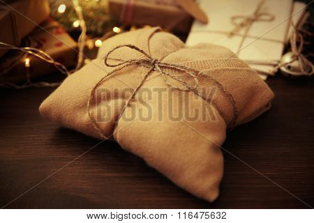 Pullover as a Christmas gift on a table