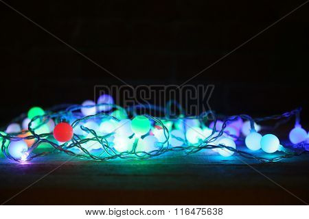 Electric Christmas garland on dark background