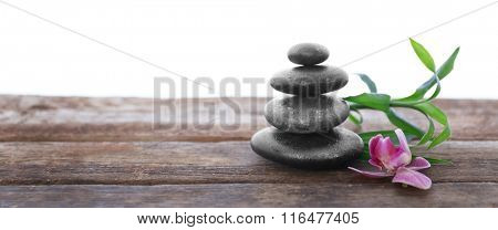 Spa stones with bamboo and purple orchid on white background