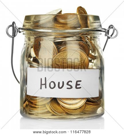 Glass jar with Ukrainian coins for house, isolated on white